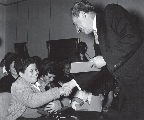Itzhak Perlman receiving a scholarship certificate from Prime Minister Moshe Sharett in 1956